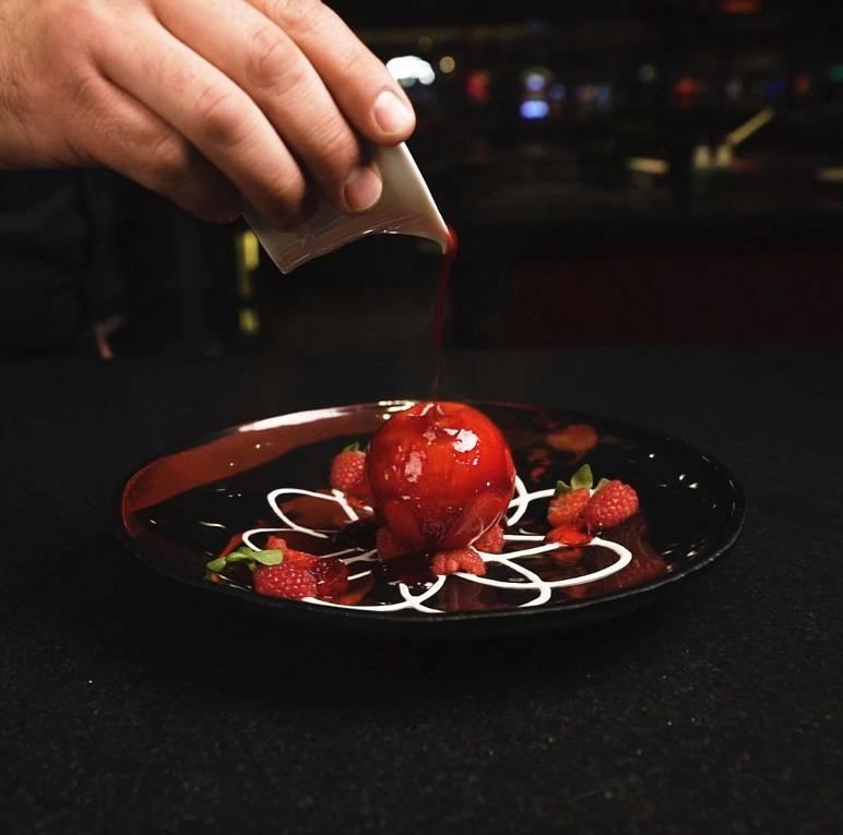 White chocolate sphere with fresh raspberry and yuzu ice cream at L'Atelier Joel Robuchon. (MGM ...