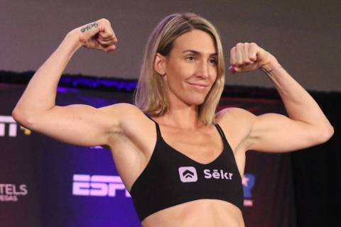 Mikaela Mayer poses on the scale during a weigh-in event at the Virgin Hotel Las Vegas, Friday, ...