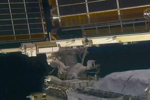 In this image taken from NASA video, NASA astronaut Shane Kimbrough, left, and French astronaut ...