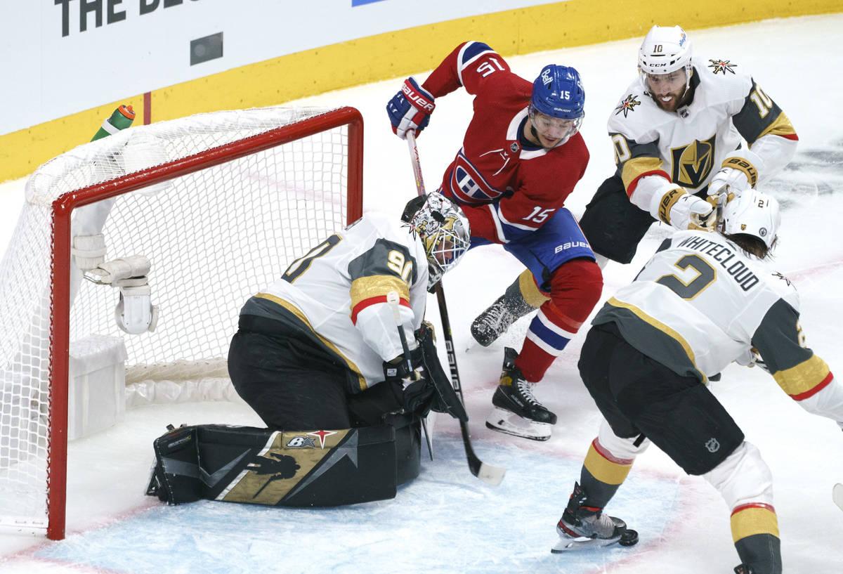 Vegas Golden Knights goaltender Robin Lehner makes a save off Montreal Canadiens' Jesperi Kotka ...