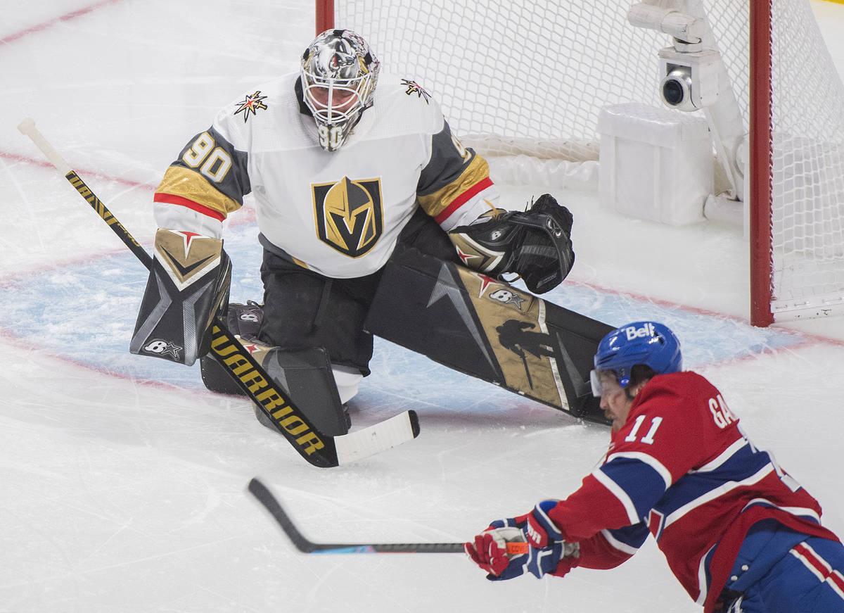 Montreal Canadiens' Brendan Gallagher (11) shoots against Vegas Golden Knights goaltender Robin ...