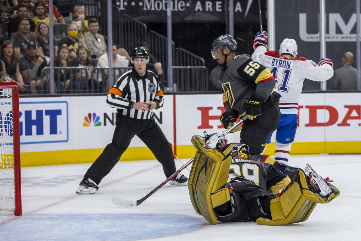 A referee looks to the net as Golden Knights goaltender Marc-Andre Fleury (29) dives but misses ...