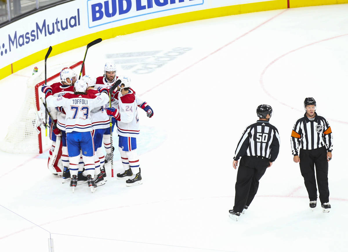 The Montreal Canadiens celebrate after defeating the Golden Knights in Game 2 in an NHL hockey ...