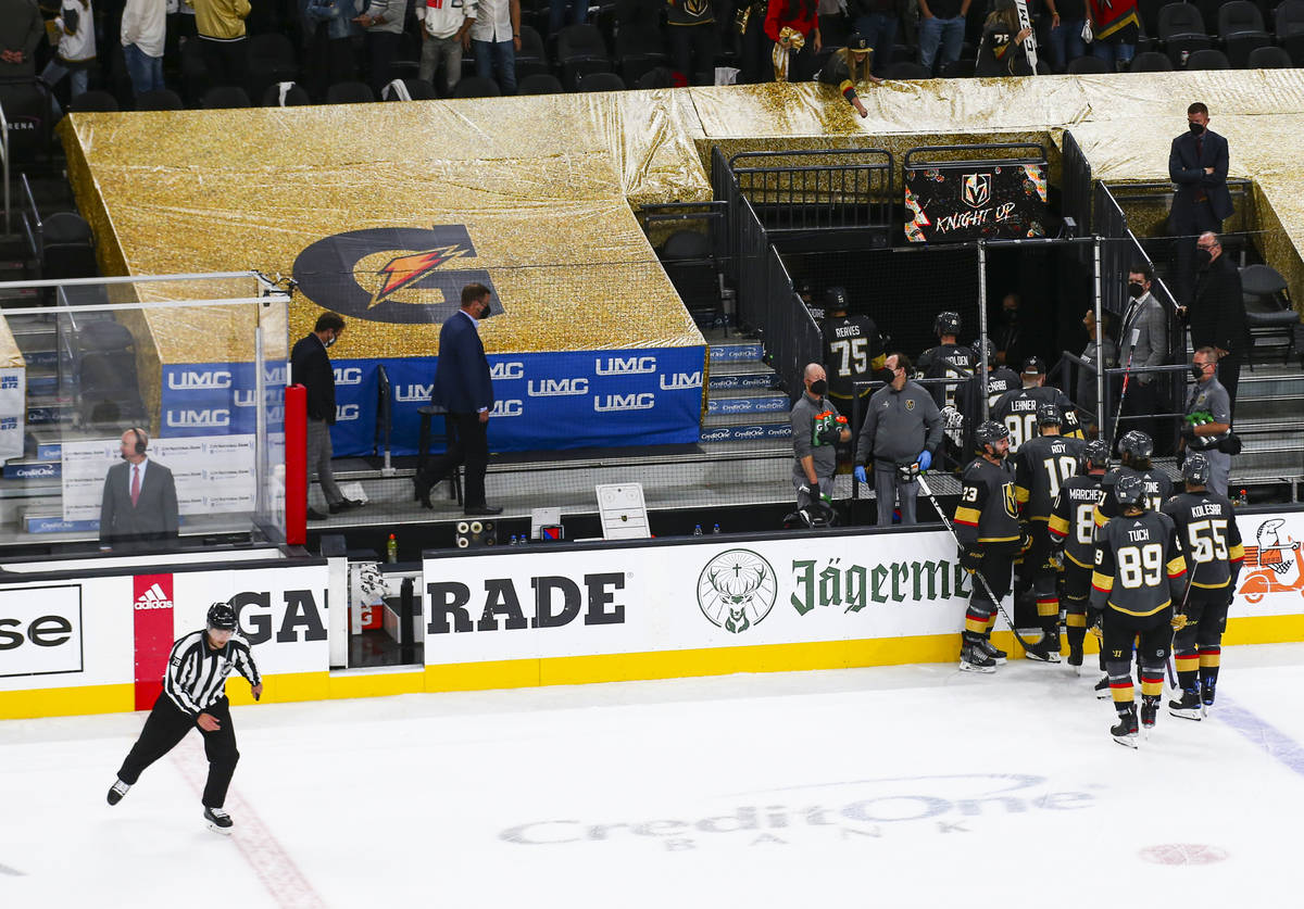 A referee skates by as the Golden Knights leave the ice following their loss to the Montreal Ca ...