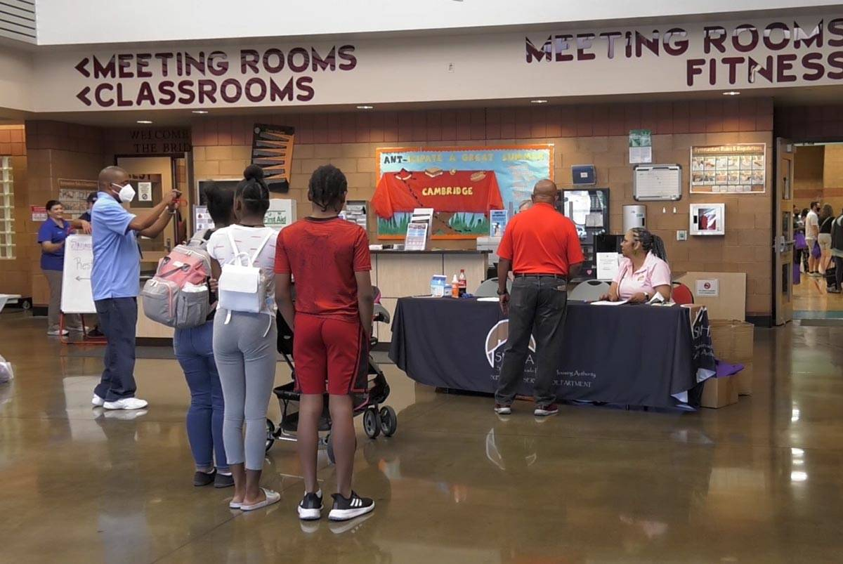 Housing Expo attendees check in with representatives from the Southern Nevada Regional Housing ...