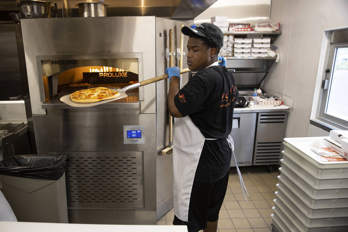 Crew member Derald Williams trains in the kitchen of Fly Pie pizza in Henderson, which opened S ...