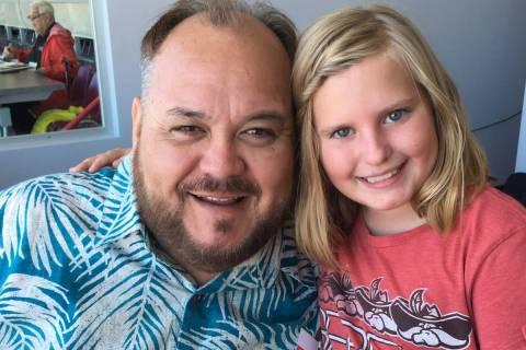 Longtime Hawaii football broadcaster Robert Kekaula, left, is shown with Brenna Bollinger, daug ...