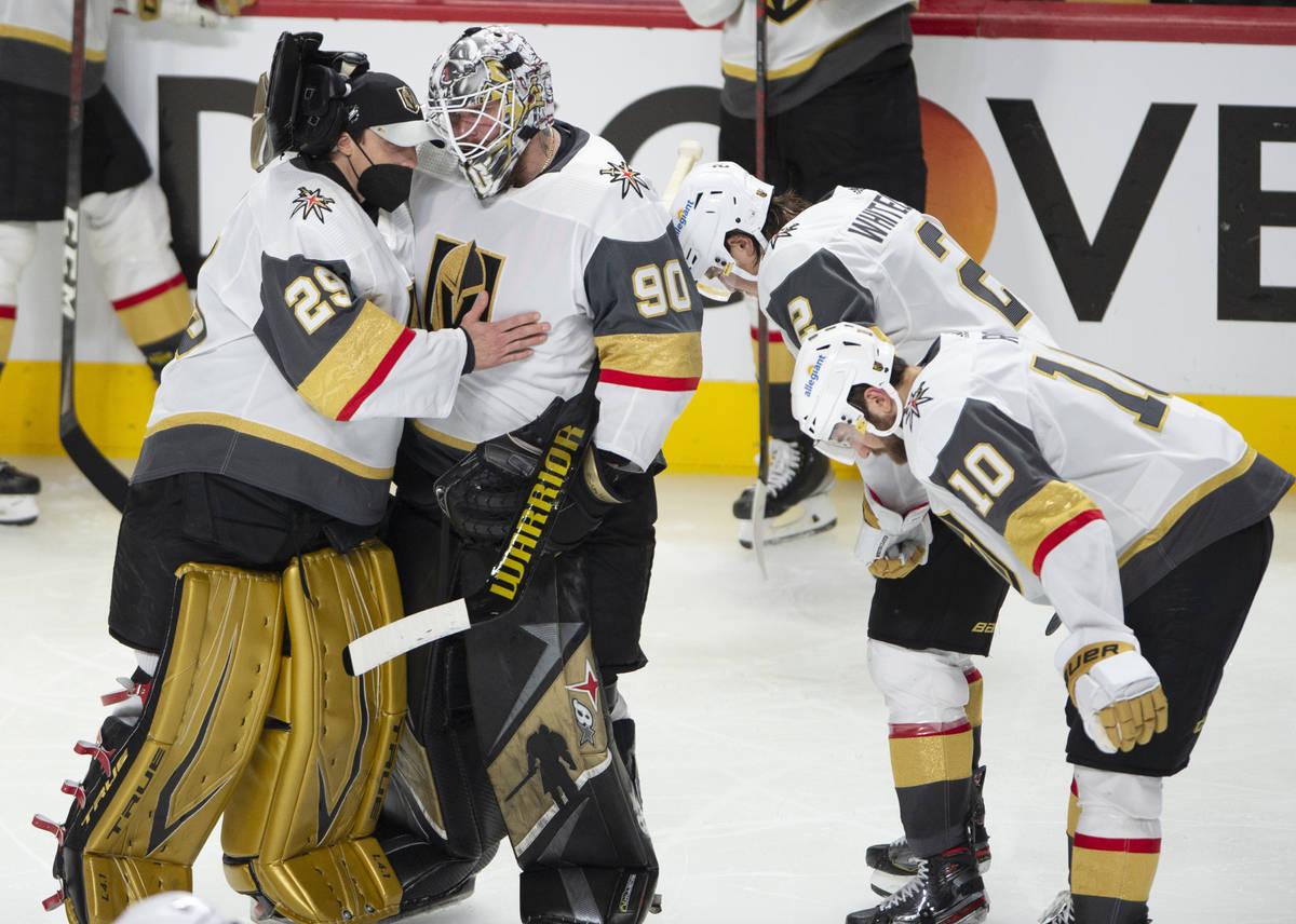 Vegas Golden Knights goaltenders Marc-Andre Fleury (29) and Robin Lehner (90) console each othe ...