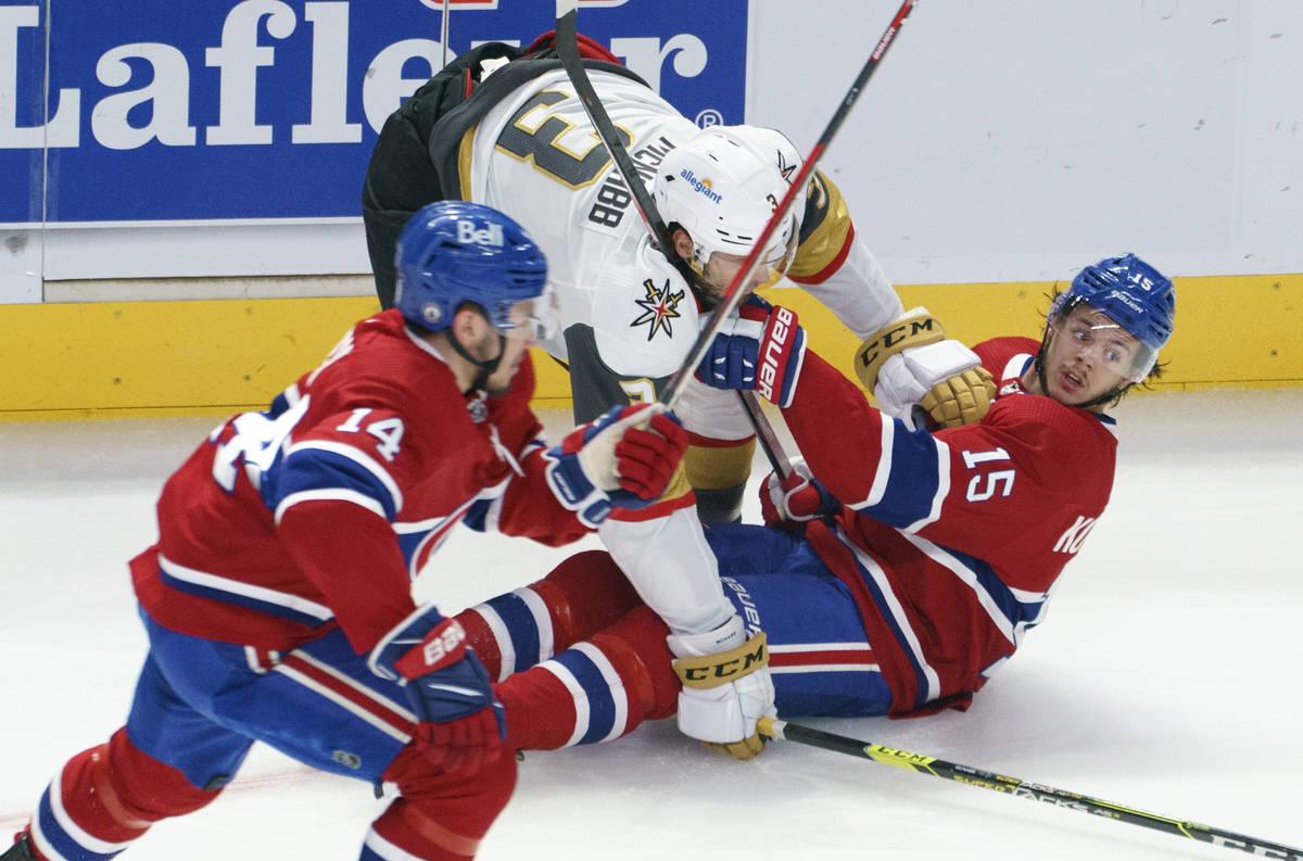 Montreal Canadiens' Jesperi Kotkaniemi (15) is dumped by Vegas Golden Knights' Peter DiLiberato ...