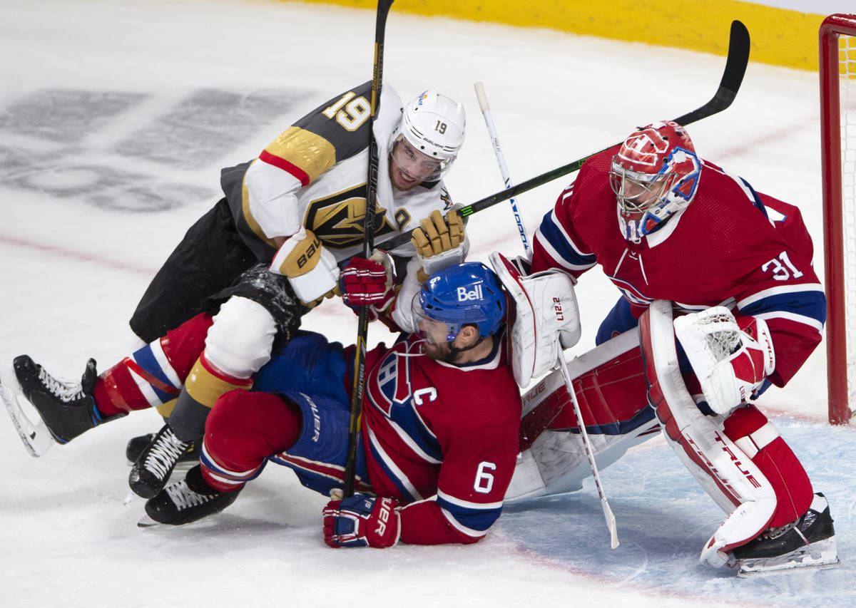 Vegas Golden Knights right wing Reilly Smith (19) battles with Montreal Canadiens defenseman Sh ...