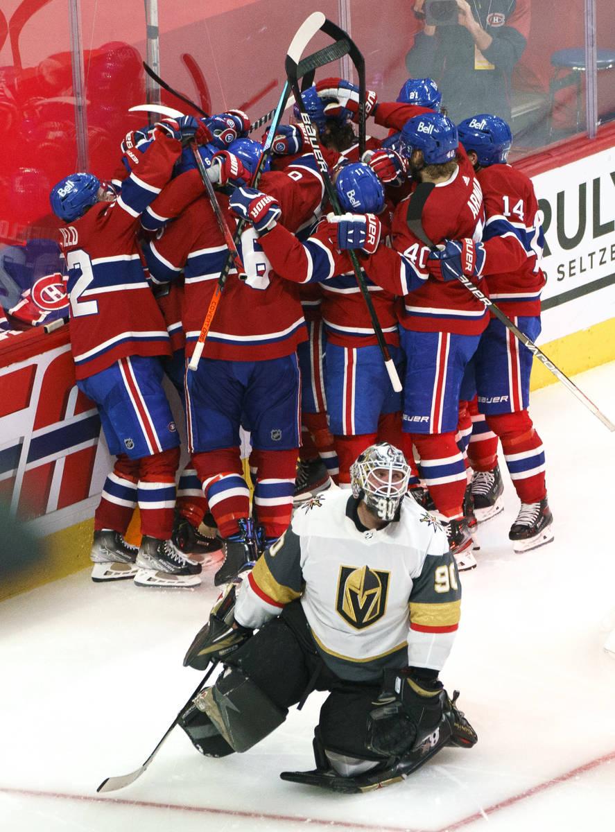 Vegas Golden Knights' Robin Lehner (90) kneels on the ice as Montreal Canadiens' Artturi Lehkon ...