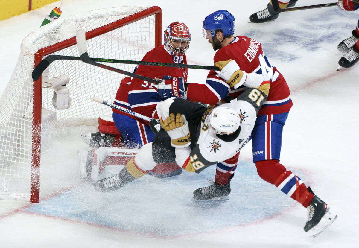 Vegas Golden Knights' Reilly Smith (19) is taken out by Montreal Canadiens defenseman Joel Edmu ...