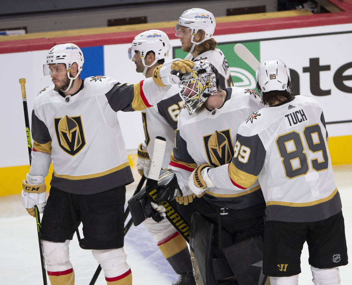 Vegas Golden Knights goaltender Robin Lehner (90) is consoled by teammates after giving up the ...