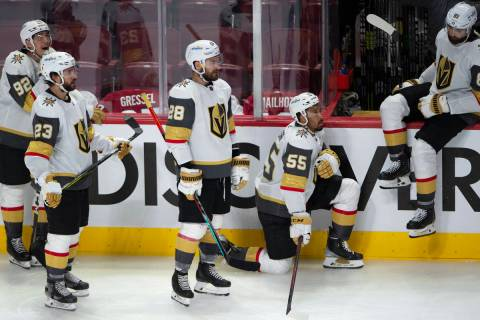 Vegas Golden Knights players watch the Montreal Canadiens celebrate following overtime in Game ...