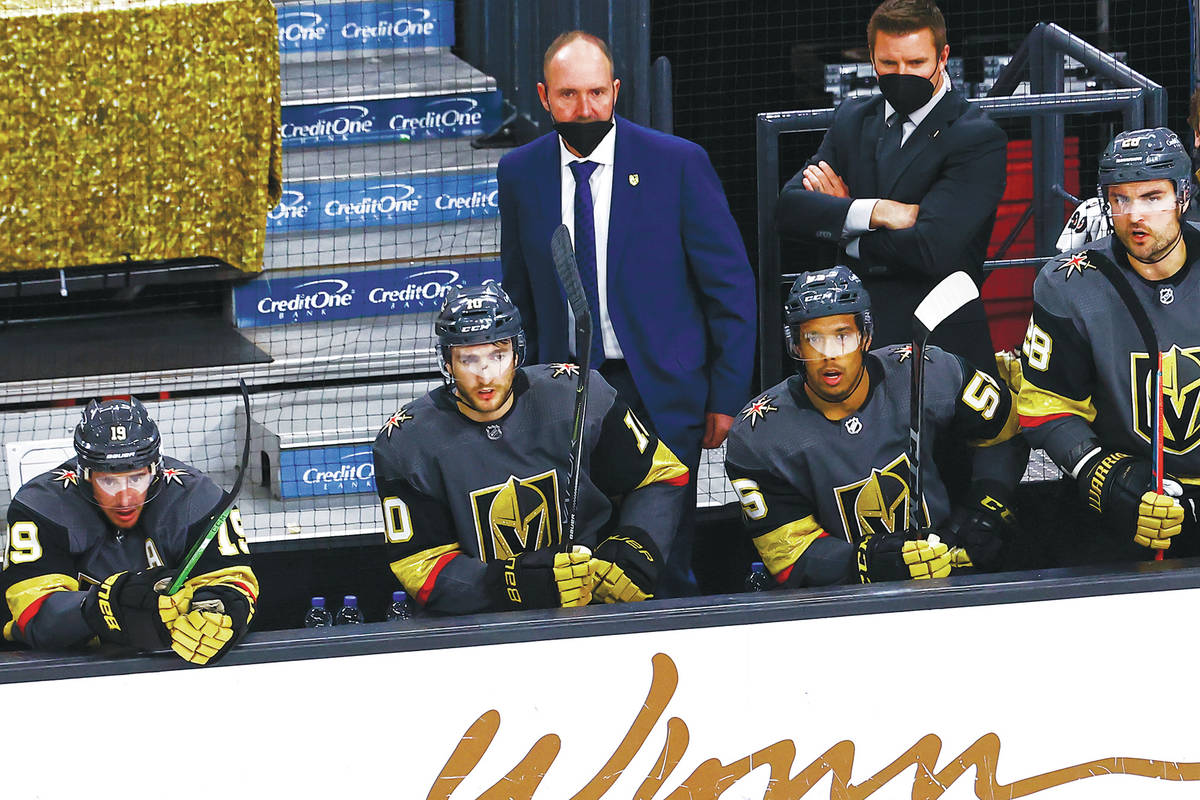 Golden Knights head coach Pete DeBoer looks on during the third period of an NHL hockey game ag ...