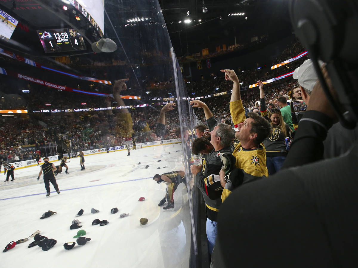 Golden Knights fans celebrate a hat trick by Jonathan Marchessault, not pictured, during the th ...