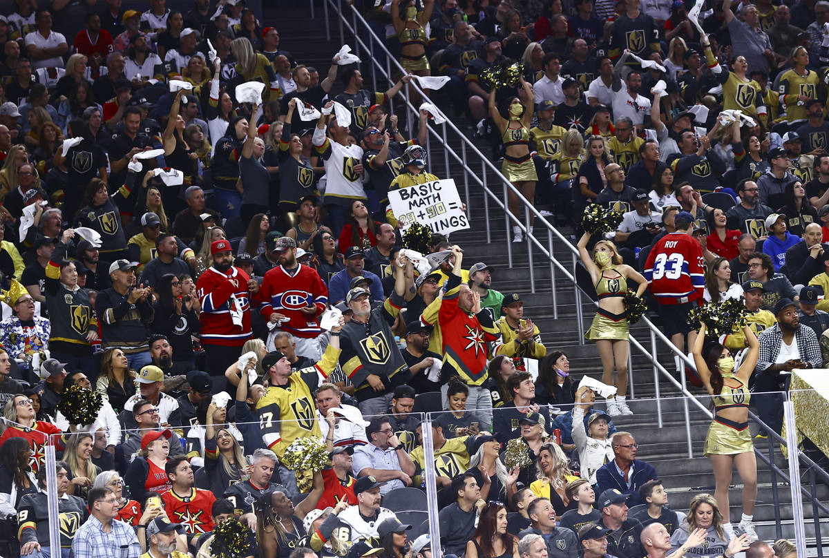 Golden Knights fans cheer during the first period of Game 5 of an NHL hockey Stanley Cup semifi ...