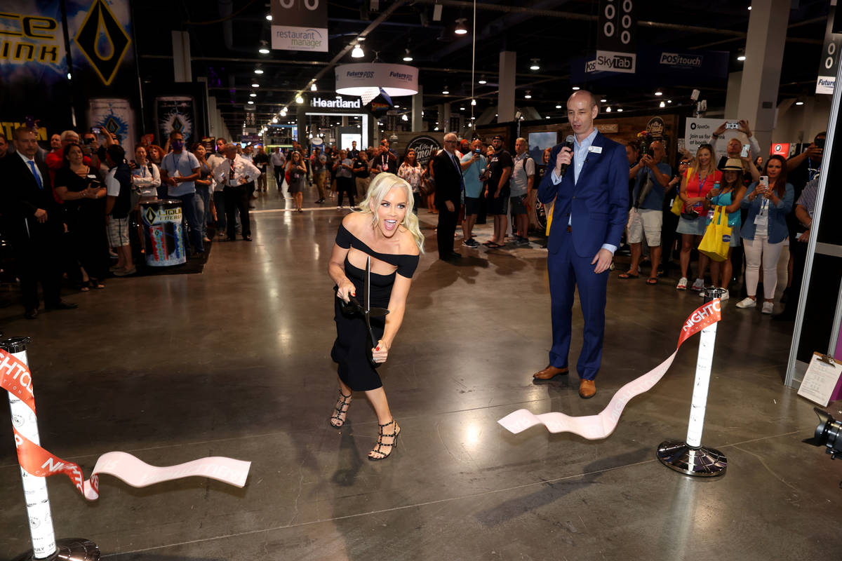Jenny McCarthy cuts the ribbon to open the show floor for the Nightclub & Bar Show at the L ...