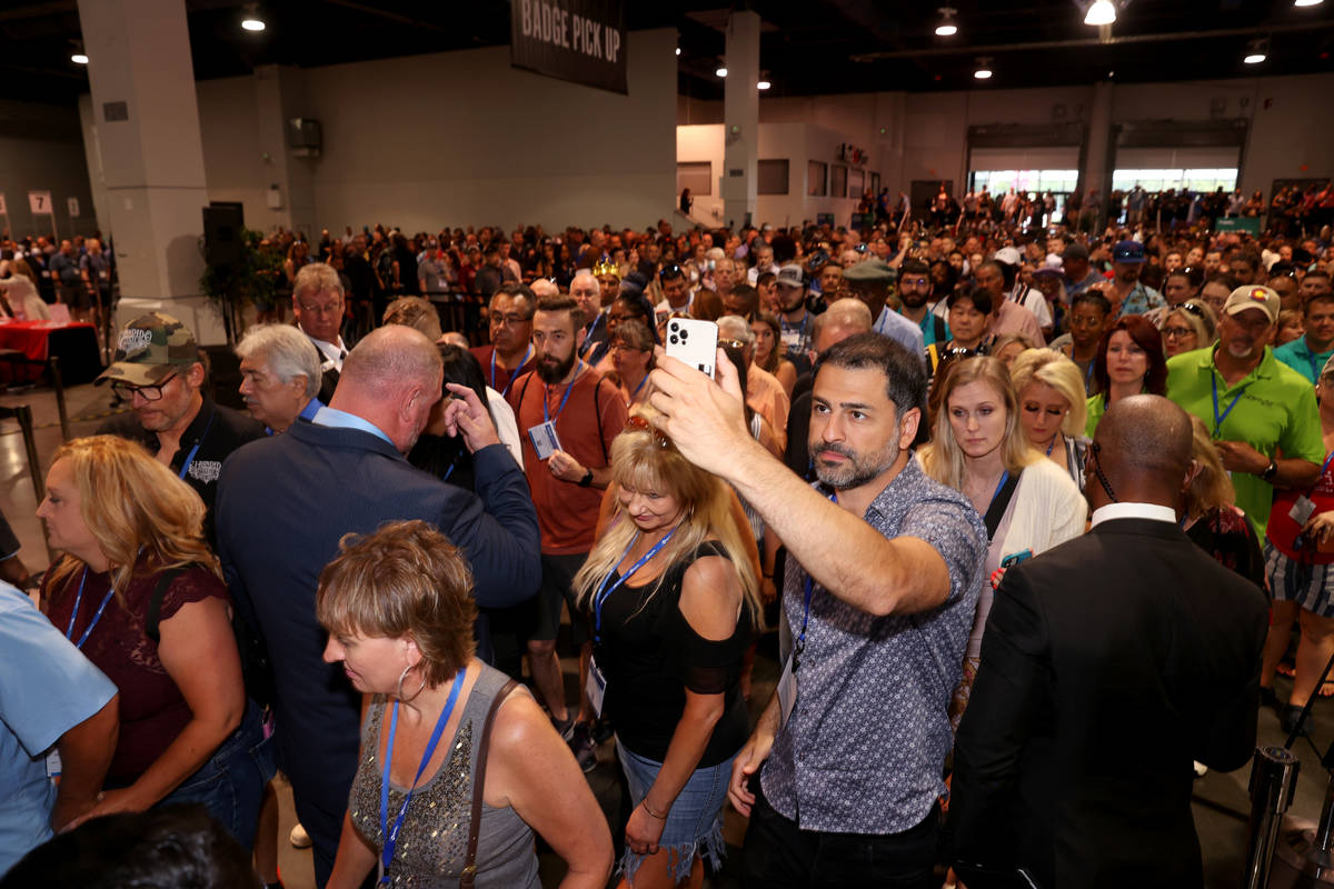 Conventioneers file in as the show floor opens at the Nightclub & Bar Show at the Las Vegas ...