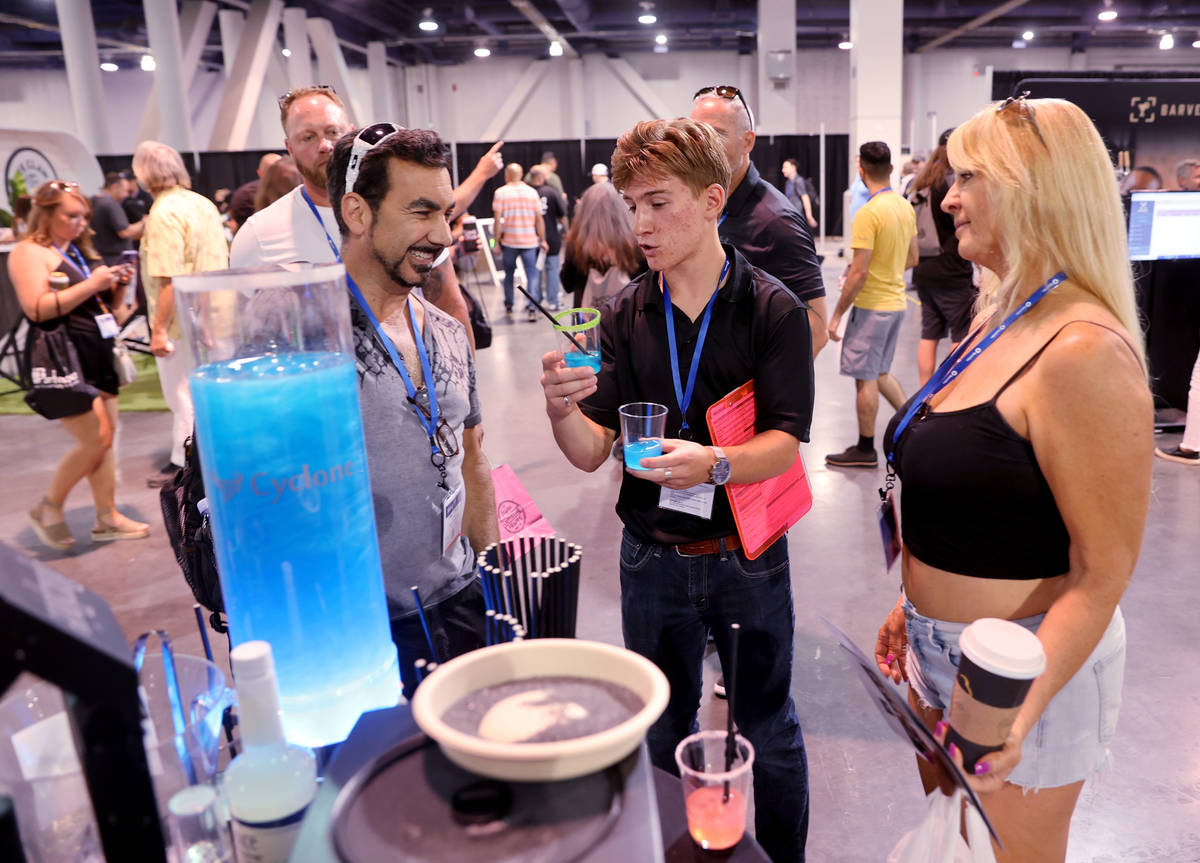 Jacob Radow of Reno, center, offers drink samples to Sal Vitalie and Laura Godby of South San F ...