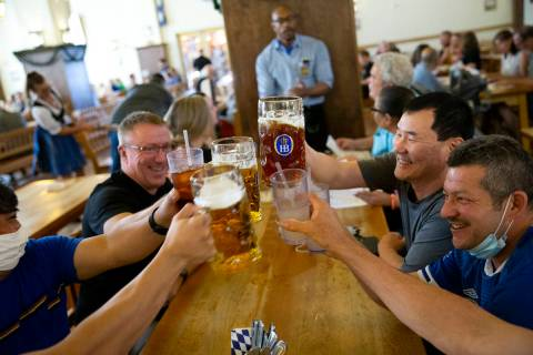 Diners at Hofbrauhaus cheers their beers on Thursday, June 17, 2021, in Las Vegas. The restaura ...