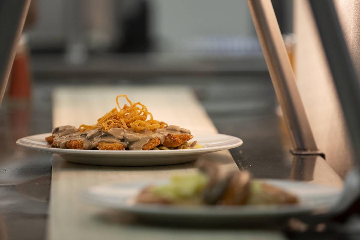 """The """"Gegrillte Hhnchenbrust,"""" chicken in mushroom sauce, heads down the conveyer belt ..."""