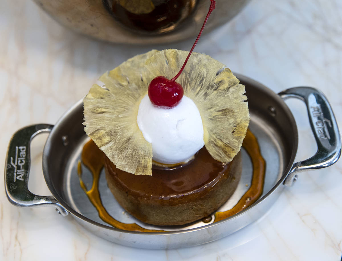 Pineapple upside down cake with a coconut sorbet is displayed at Delilah Supper Club at Wynn, ...