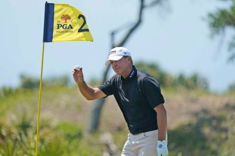 Steve Stricker tips his ball to the crowd after an eagle on the second hole during the second r ...