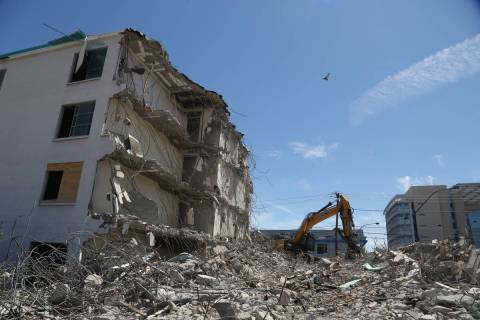 Demolition work continues on the El Cid Hotel in downtown Las Vegas, Wednesday, June 12, 2019. ...