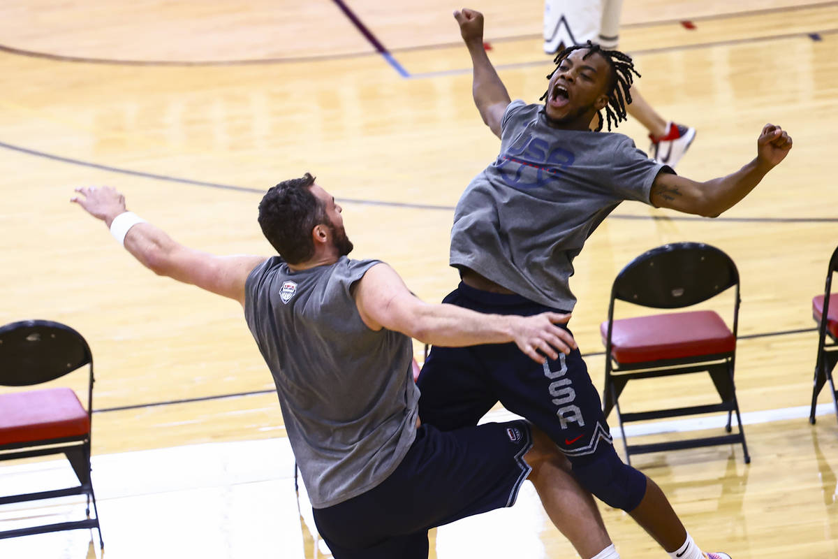 Kevin Love, left, and Darius Garland celebrate after taking turns shooting during USA Basketbal ...