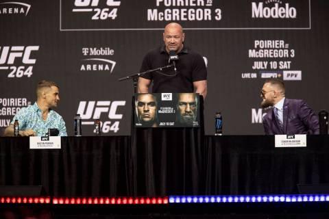 Dustin Poirier, left, with Conor McGregor, right, and UFC president Dana White, participate dur ...