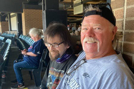 Las Vegan Mike Wurst, foreground, and his longtime friend and fellow Chicago White Sox fan Larr ...