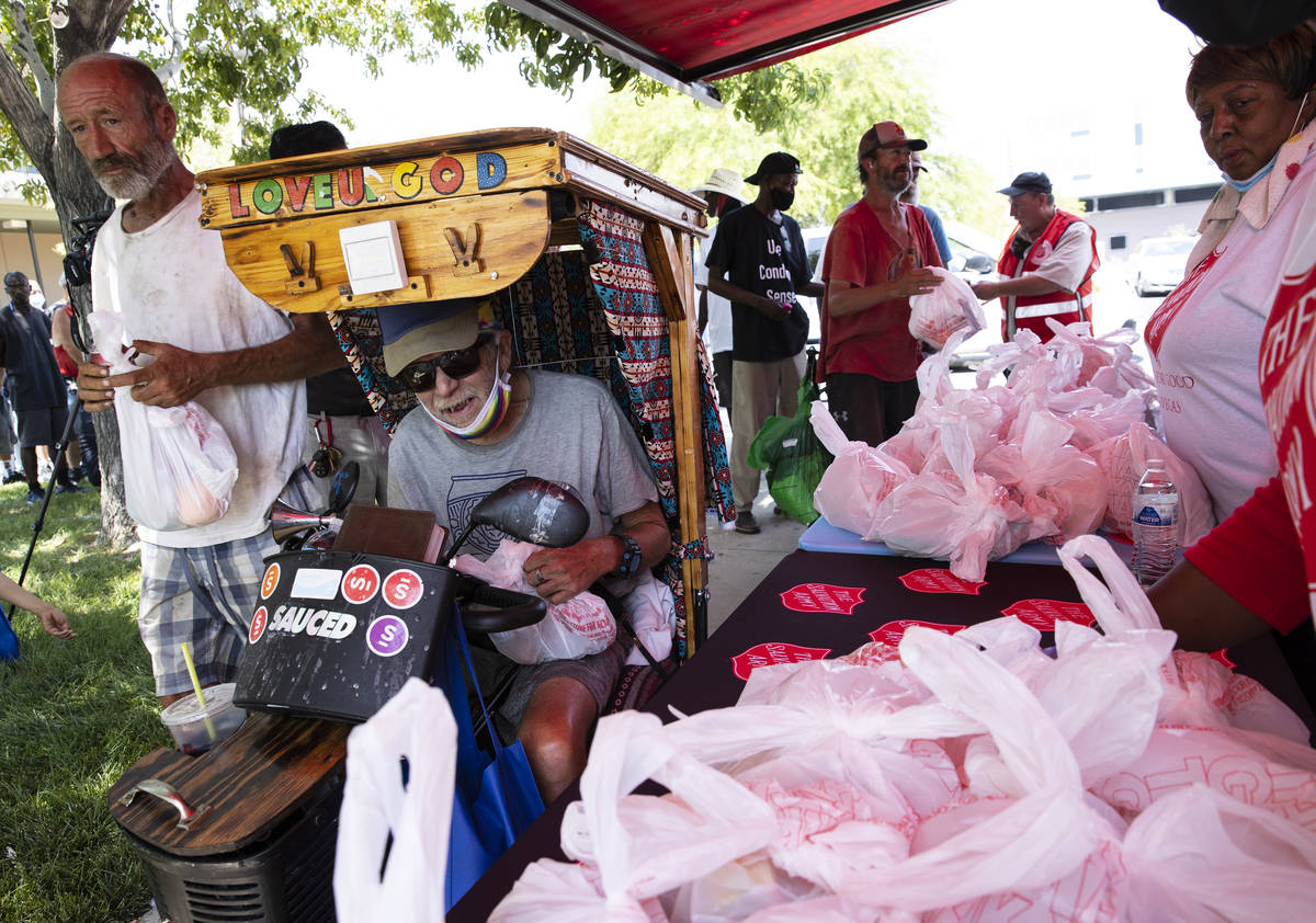 Keith Zeipz waits in a queue to receive free food from the Salvation Army food truck outside Du ...
