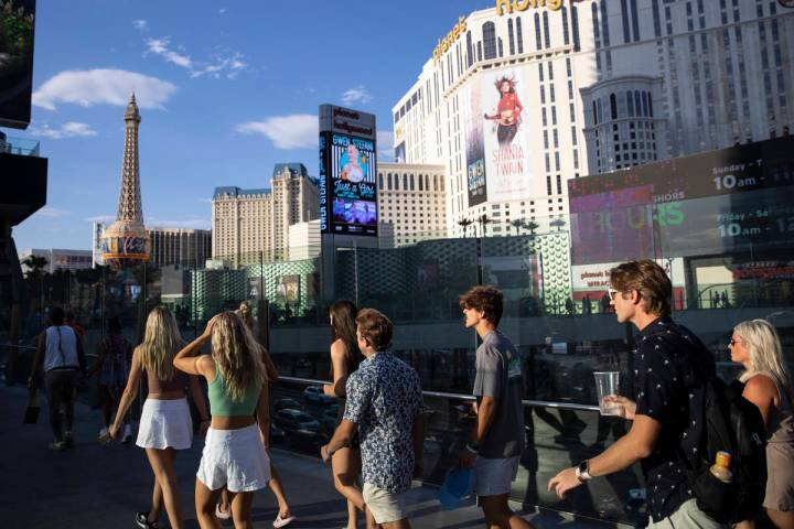 People visit the Strip near Planet Hollywood hotel-casino in Las Vegas July 3, 2021. Clark Coun ...