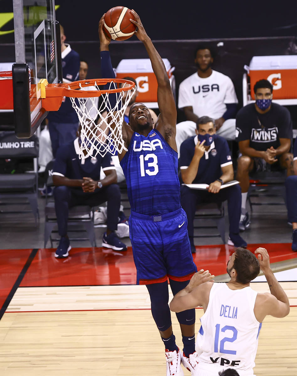 USA's Bam Adebayo (13) dunks the ball in front of Argentina's Marcos Delia (12) during t ...