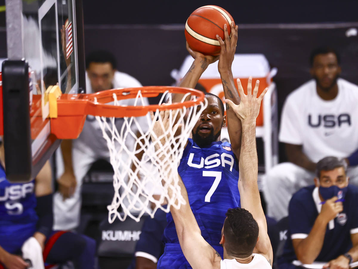 USA's Kevin Durant (7) shoots over Argentina's Patricio Garino during the first h ...