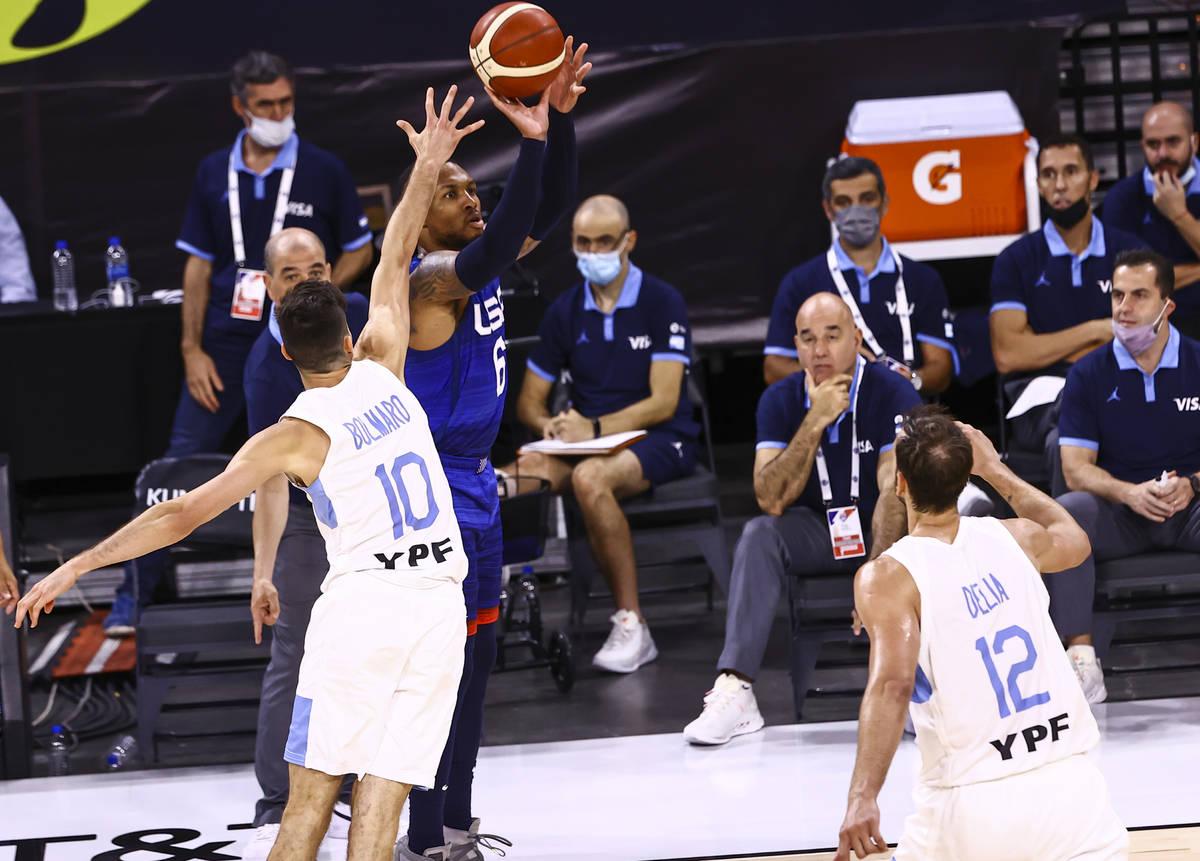 USAÕs Damian Lillard (6) shoots as ArgentinaÕs Leandro Bolmaro (10) defends during th ...