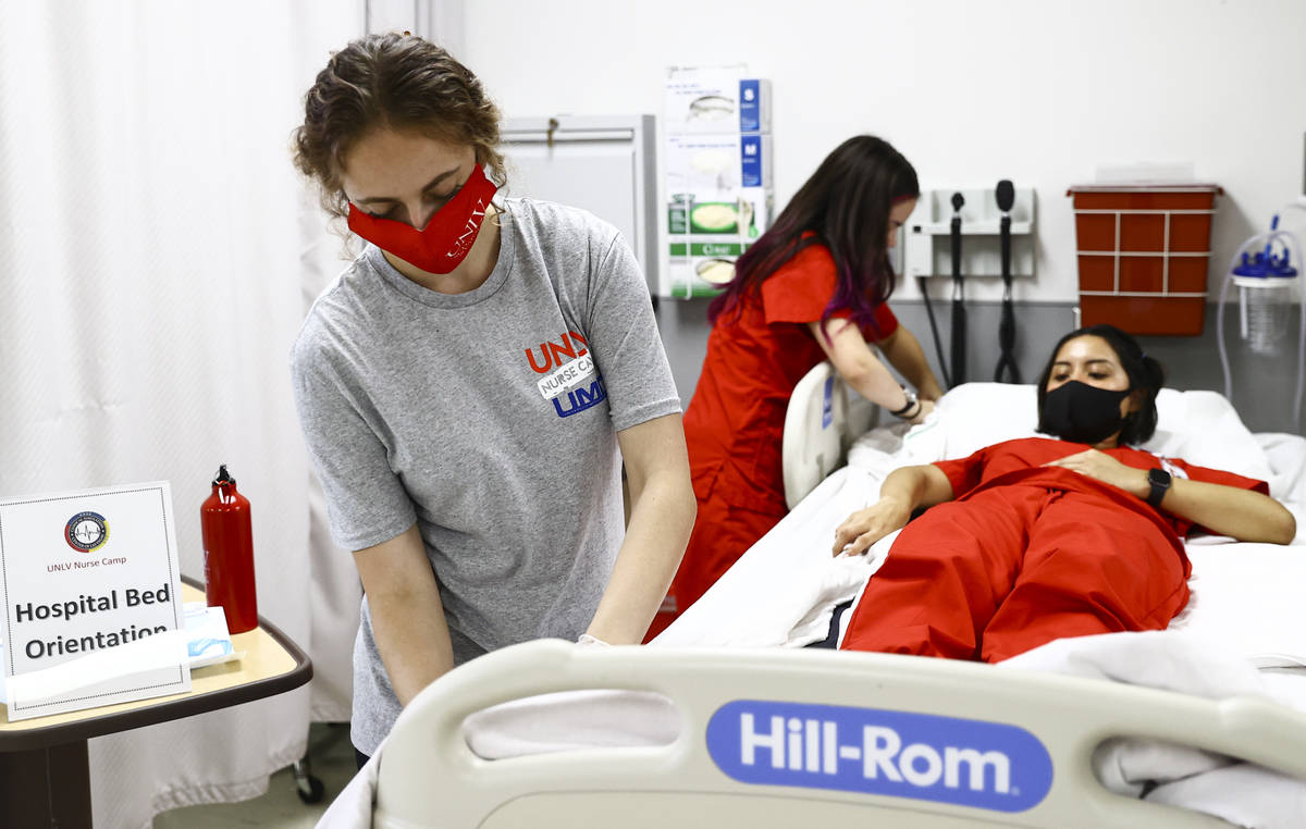 West Career & Technical Academy student Jenna Le Piere, left, participates at the hospital bed ...