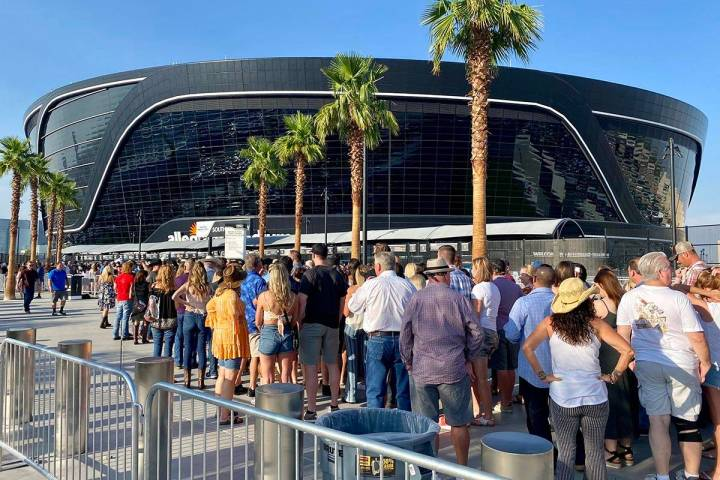 Attendees for a Garth Brooks concert line up at Allegiant Stadium on Saturday, July 10, 2021, i ...