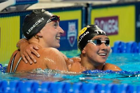 Katie Ledecky, left, hugs Erica Sullivan after winning the women's 1500 freestyle during wave 2 ...