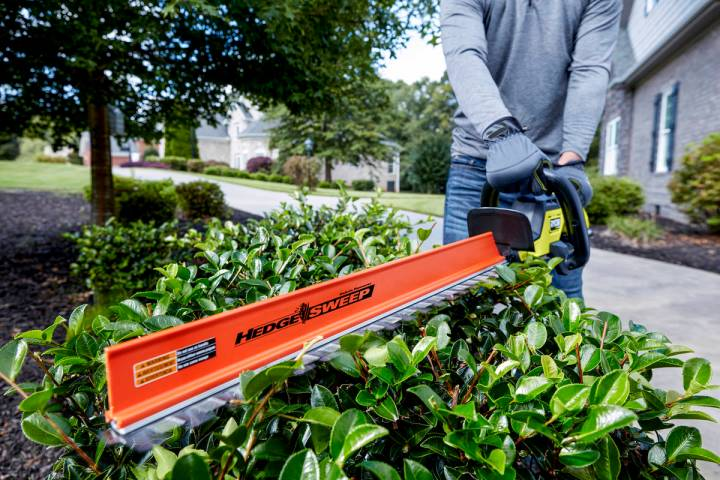 The 40-volt Ryobi 26-inch brushless hedge trimmer is easier to maneuver than corded trimmers. ( ...