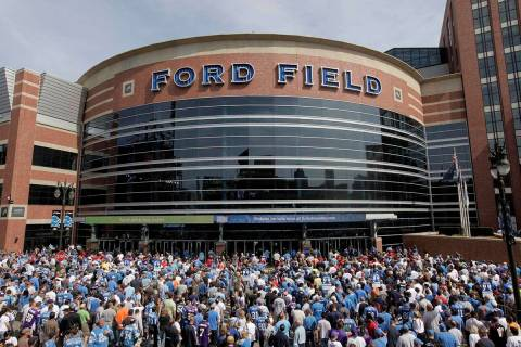 Fans arrive to Ford Field before and NFL football game between the Detroit Lions and Minnesota ...