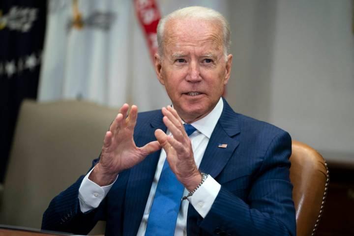 President Joe Biden speaks during a meeting on reducing gun violence, in the Roosevelt Room of ...