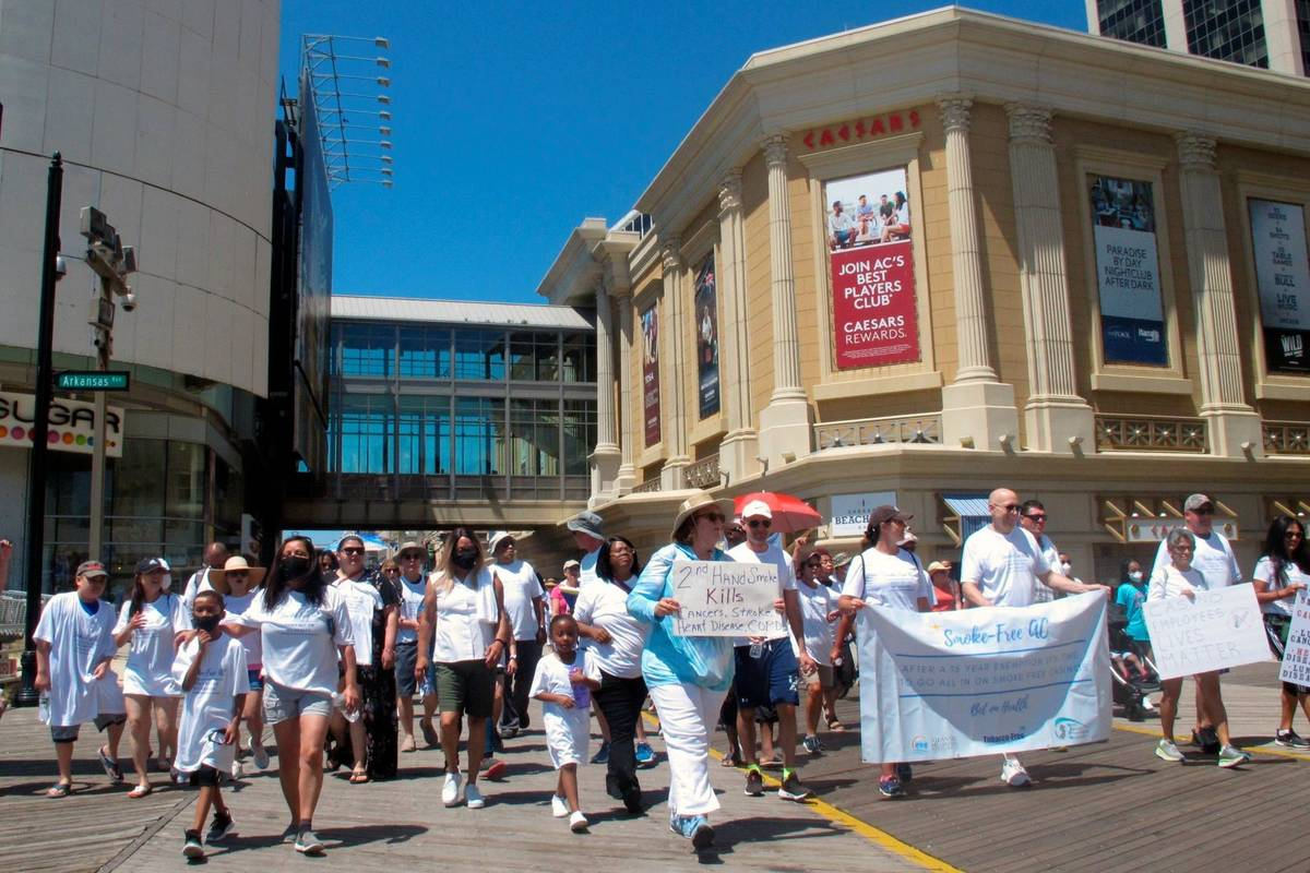 Casino workers and smoking opponents march on the Atlantic City N.J., Boardwalk on Wednesday, J ...