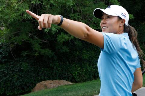 Danielle Kang gestures after finishing the 18th hole during the fourth round of the Bank of Hop ...