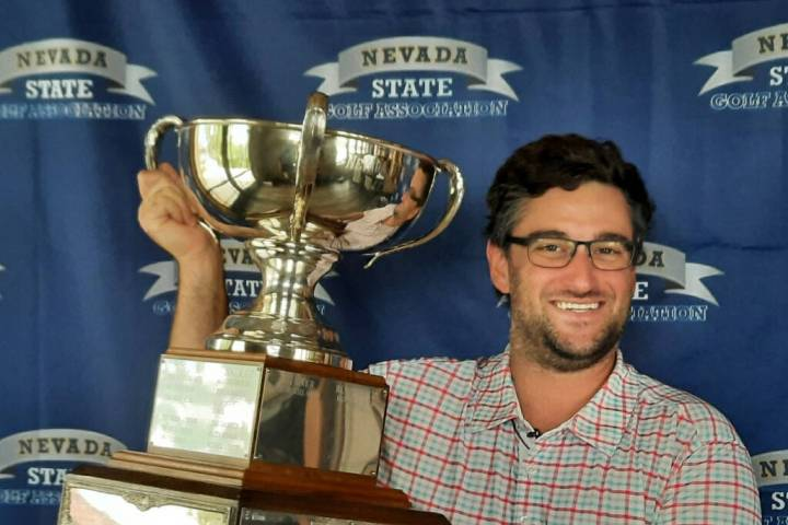 Josh Goldstein shows off the trophy after winning the Nevada State Amateur Championship at Red ...