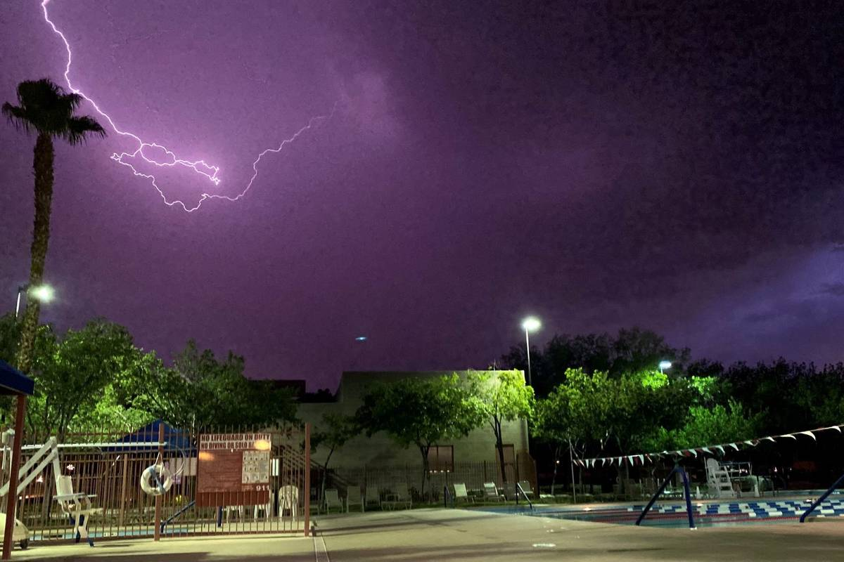 Lightning illuminates the sky above the Trails Pool in Summerlin on Tuesday, July 20, 2021. (Co ...
