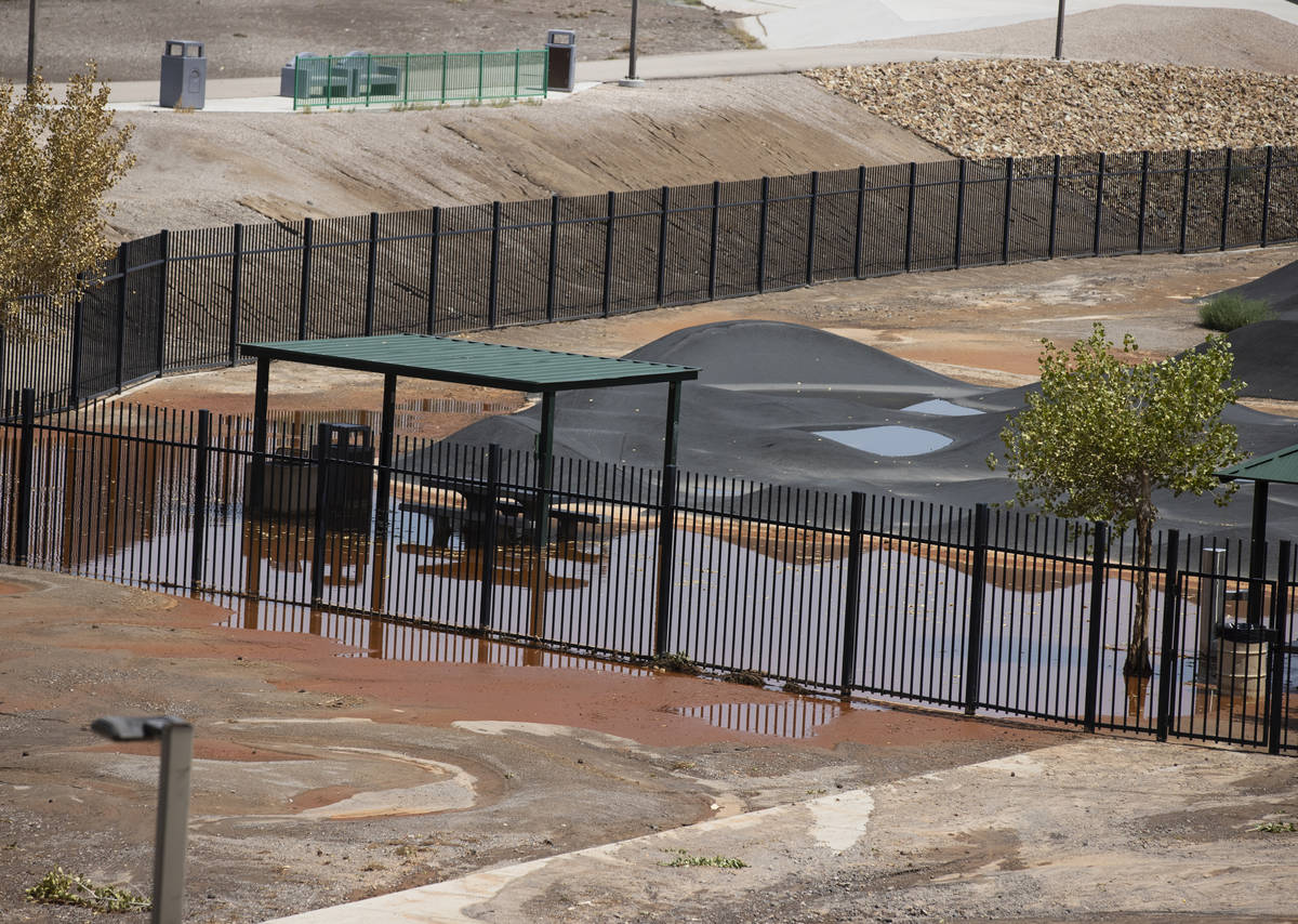 A playground at Arroyo Grande Sports Complex is surrounded by flood water, on Friday, July 23, ...
