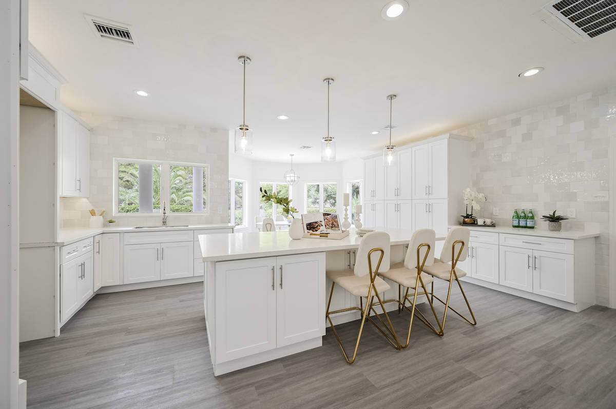 The gourmet kitchen features the latest appliances was recently remodeled. (LUXE Estates & Life ...