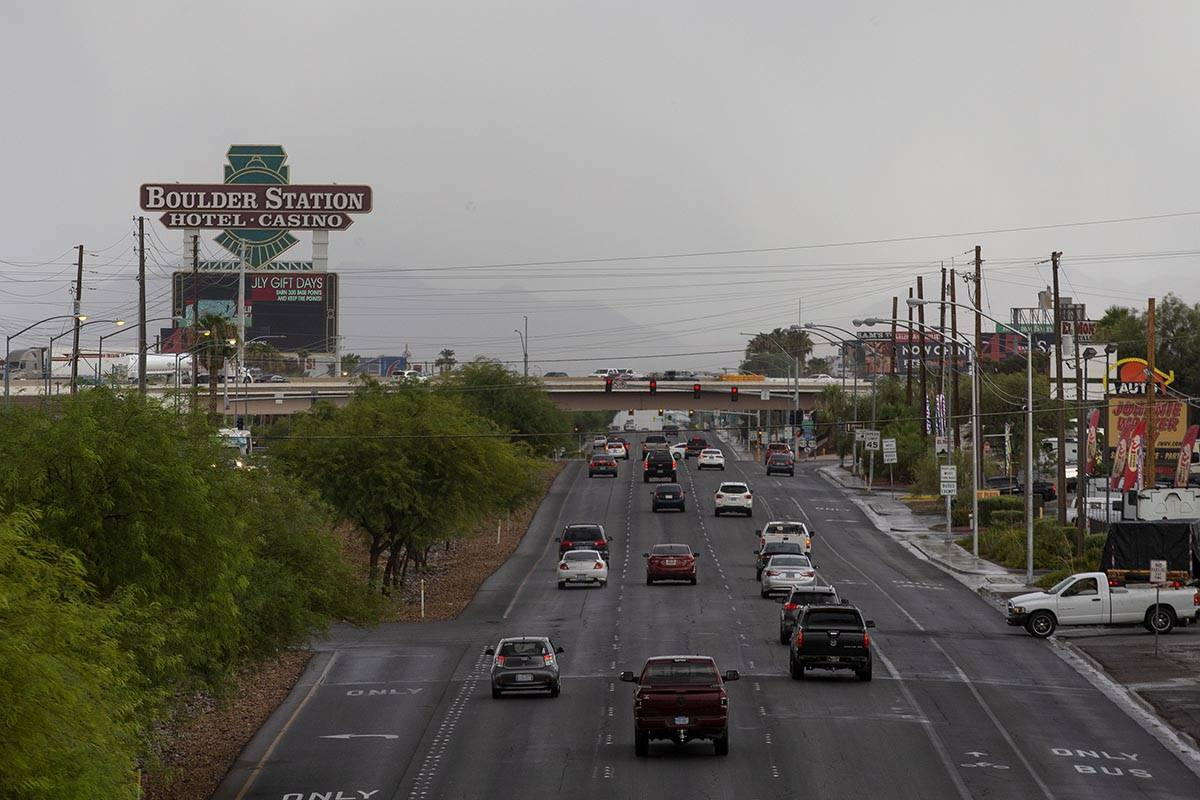 Traffic moves on Boulder Highway with stormy skies in the background on Thursday, July 22, 2021 ...